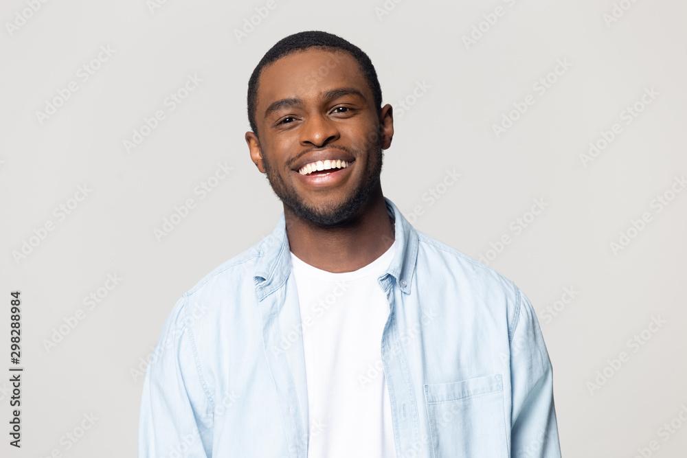 Fototapeta Head shot portrait happy African American man with healthy smile