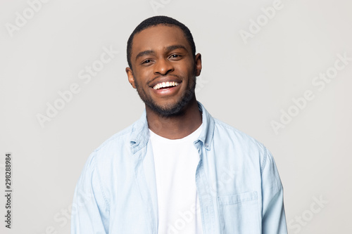 Obraz Head shot portrait happy African American man with healthy smile - fototapety do salonu