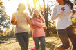 Group of female friends jogging at the city park in the morning.Autumn season.