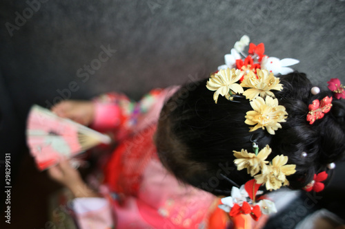 фотография  A girl wearing kimono visits a shrine at Shichigosan celebration for 7 and 5 and