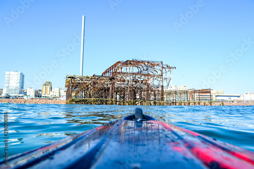 Fototapeta  Kayak on the sea at Brighton Pier in Sussex, UK