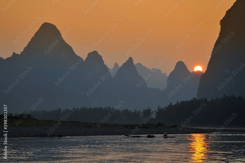 Fototapety, obrazy: Scenic sunset over Karst mountains formations in Guilin, one of China most popular tourist destinations.