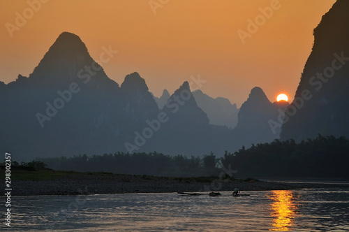 Foto auf Leinwand Landschaft Scenic sunset over Karst mountains formations in Guilin, one of China most popular tourist destinations.