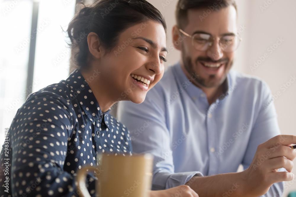 Fototapeta Diverse office workers couple having a coffee break