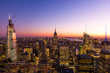 New York City skyline with cityscape and skyscraper in Manhattan at sunset.