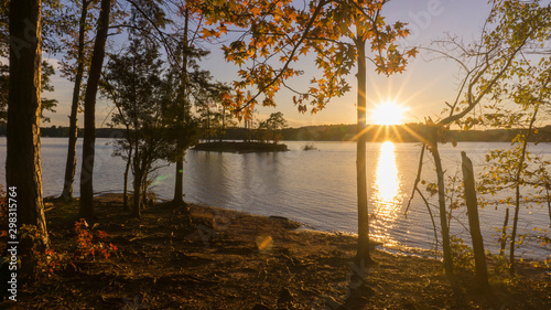 A scenic autumn view of a sunset over Lake Norman in North Carolina Canvas Print