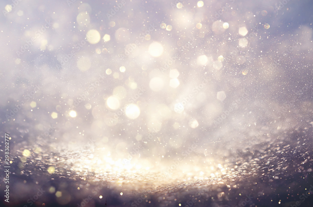 Fototapeta abstract background of glitter vintage lights . silver and white. de-focused