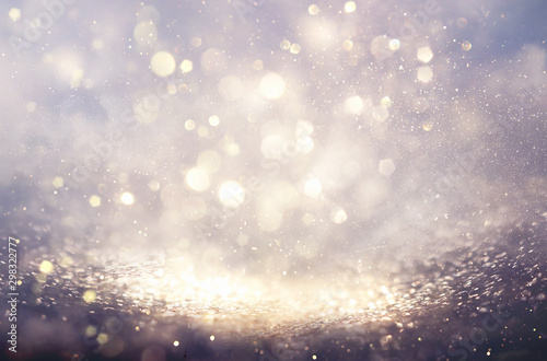 abstract background of glitter vintage lights . silver and white. de-focused