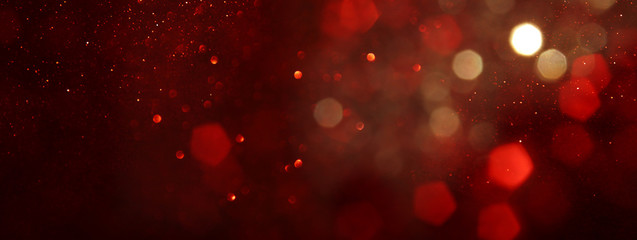 background of abstract red, gold and black glitter lights. defocused. banner