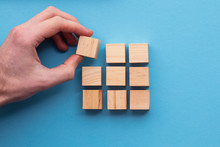 Hand Choosing A Wooden Block F...