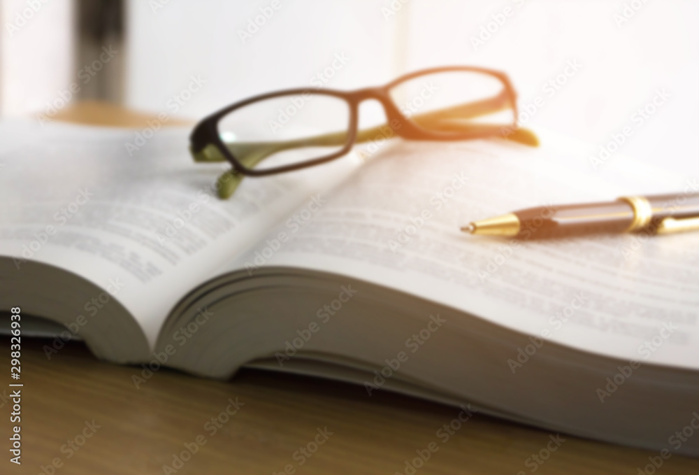 Fototapety, obrazy: blur image of book ,glasses and pen , reading for the exam concept