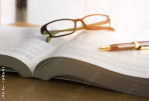 blur image of book ,glasses and pen , reading for the exam concept Fotobehang