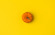 Autumn Flat Lay Composition. Pumpkin On Yellow Background.