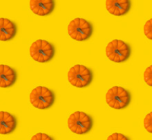 Autumn Seamless Pattern. Pumpkins On Yellow Background