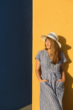 Woman Standing In Front Of Yellow And Blue Walls