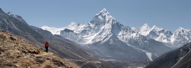Young woman hiking in Sagarmatha National Park, Everest Base Camp trek, Nepal