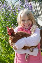 Happy Girl Hugging Hen