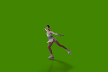 Figure Skating Girl Isolated On Green Background.