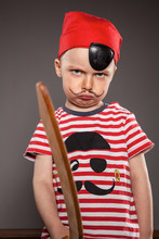 Portrait Of Angry Looking Little Boy Dressed As Pirate