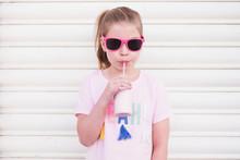 Young Girl Wearing Pink Sungla...