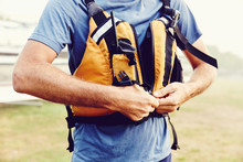 Man Zips Up His Life Jacket In...