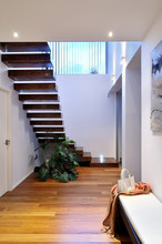 Contemporary House Hall With Wooden Stairs