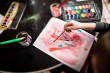 Young Child's Hand Painting Wi...
