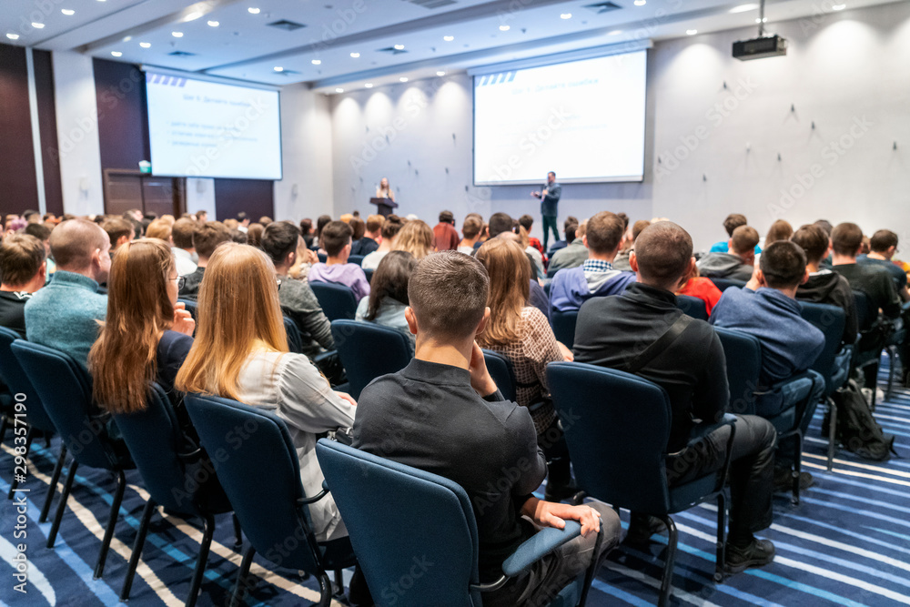 Fototapeta Image of a conference that takes place in a large conference room, workshop for young professionals, training in a large conference room, adult training