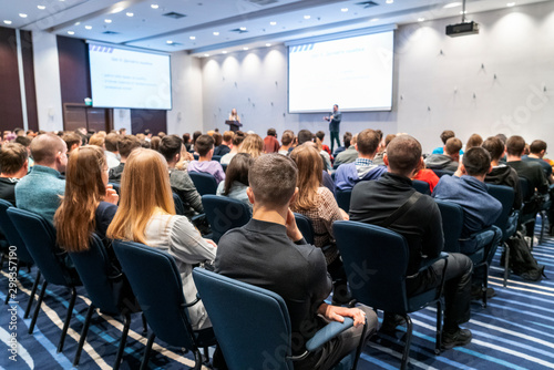 Image of a conference that takes place in a large conference room, workshop for Fotobehang