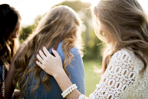 Closeup shot of a female blessing her friends with a blurred background Canvas Print