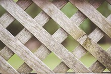 Closeup Shot Of A Wooden Criss-cross Fence With A Blurred Background - Great For A Background