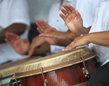 Hands Playing Puerto Rican Folk Music In A Typical Latin Drums