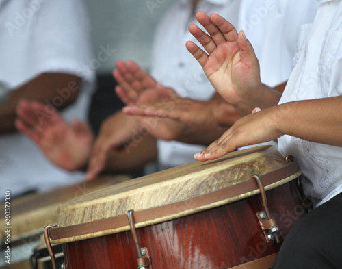 Hands playing puerto rican folk music in a typical latin drums - 298372330