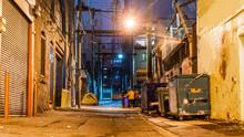 Dark And Scary Vintage Cobblestone Brick City Alley At Night In Vancouver, British Columbia, Canada.