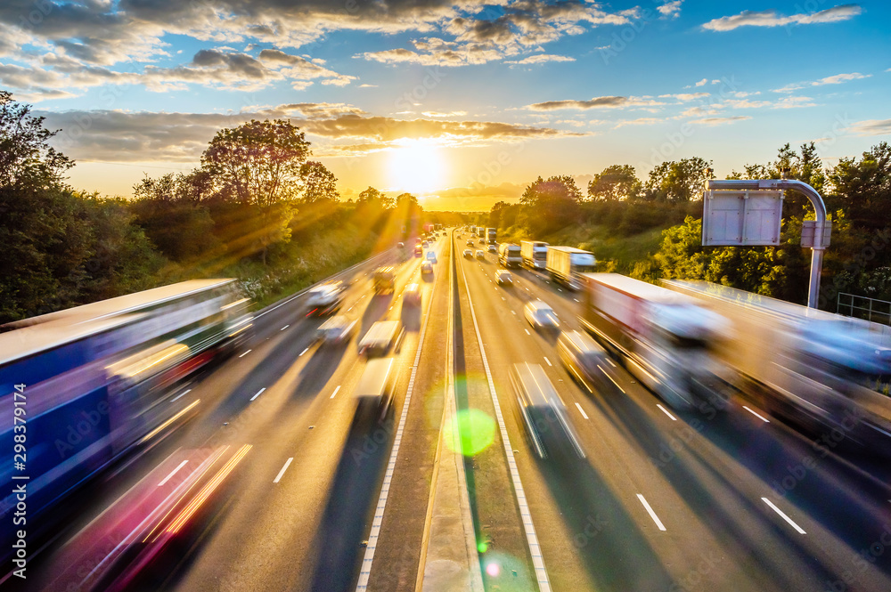 Fototapety, obrazy: heavy traffic moving at speed on UK motorway in England at sunset
