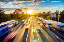 Heavy Traffic Moving At Speed On UK Motorway In England At Sunset