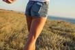 paradise coast legs of a young girl walk along the seashore