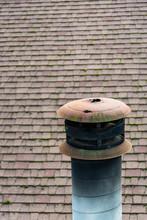Suburban Rooftop, Mossy Asphalt Shingles, Rusty Chimney Cap