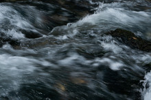 Flowing Blurry Water Of A Rive...