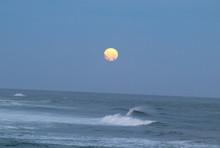 Moon Above Crashing Ocean Waves
