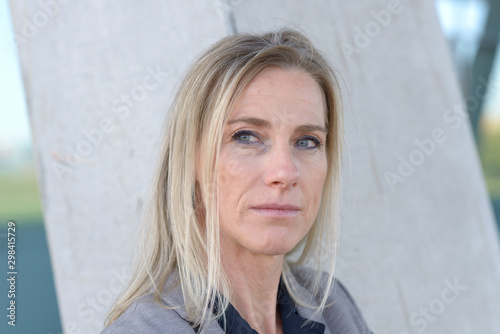 Middle-aged blond woman deep in thought