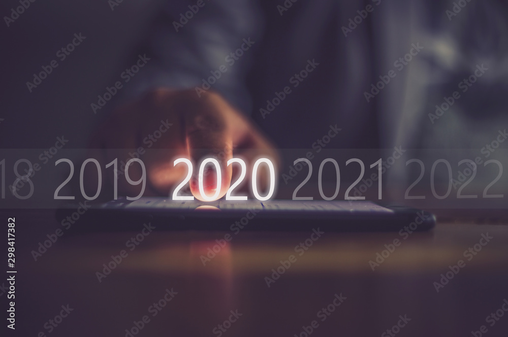 Fototapety, obrazy: Business men press numbers 2020 at the mobile phone screen .Concept welcome merry christmas and happy new year 2020