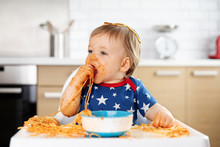 Messy Baby Eating Spaghetti Wi...