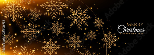 Fototapeta black and gold snowflakes merry christmas banner design obraz