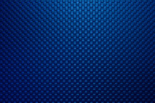 The Dark Blue Square Block Shape Embossed Texture Background With The Lighting On The Top. The Seamless Pattern Of Square Shape Embossed On The Plastic Material Sheet With Golden Lighting .