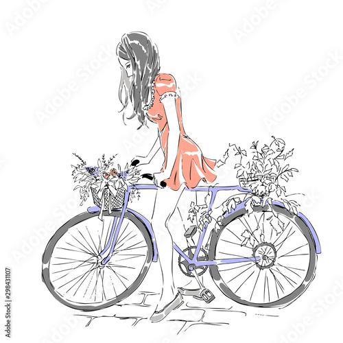 Fototapety, obrazy: Summer or spring time, cute elegant girl riding a bike with floral baskets