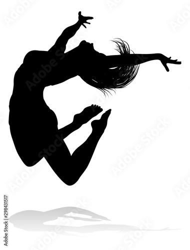 Fotografia, Obraz A silhouette woman dancing in mid air jumping
