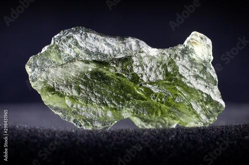 Macro photography of a moldavite stone on a black background Canvas Print