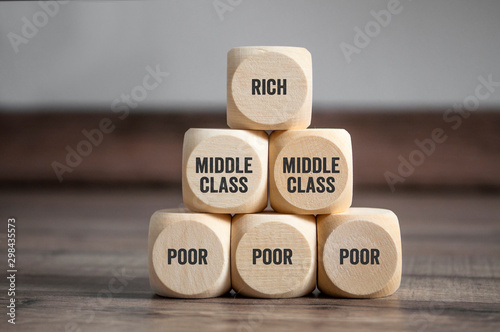 Pyramid made of cubes and dice with rich, middle class and poor on wooden backgr Canvas Print