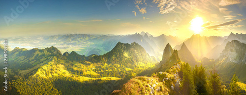 Fotobehang Geel Autumn valley at sunrise in Alps